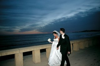 newlyweds-walking-outside-with-ocean-view