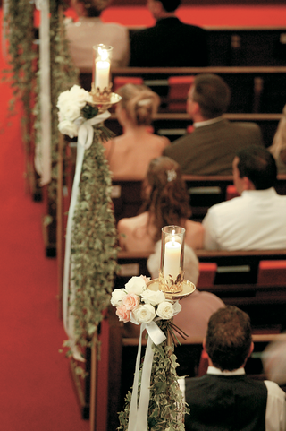 red-aisle-lined-with-greenery-and-candles
