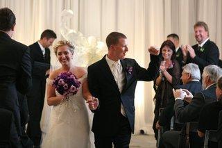 newlyweds-exit-indoor-ceremony