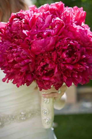 hot-pink-wedding-bouquet-with-blooming-peonies