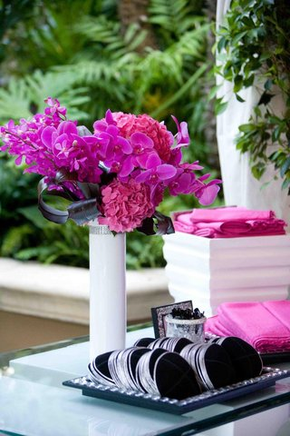 black-yarmulkes-with-silver-borders-on-table-with-pink-flowers