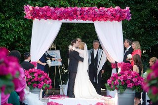 white-drapery-on-chuppah-with-hot-pink-flowers