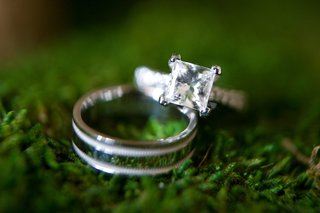 diamond-wedding-ring-and-mens-band-on-grass