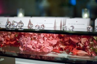 pink-hydrangeas-under-glass-tabletop-with-seating-cards