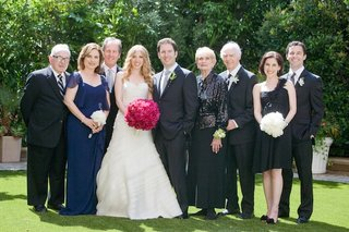 bride-and-groom-with-grooms-family-and-mother