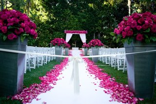 wedding-ceremony-on-grass-lawn-with-hot-pink-flowers