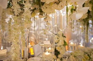 tea-light-candle-in-suspended-glass-orb-cascading-orchids