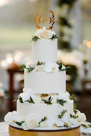 wedding-cake-round-white-tiers-white-orchid-and-rose-flowers-greenery-gold-laurel-wreath-cake-topper