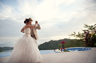 bride-and-groom-dance-by-resort-pool-in-costa-rica