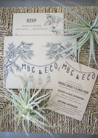 rustic-wedding-invitations-natural-organic-with-green-leaf-decorations-on-woven-burlap-mat