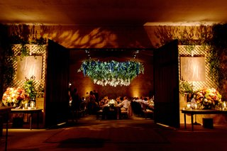 entrance-to-wine-barrel-room-rehearsal-dinner-with-chandelier