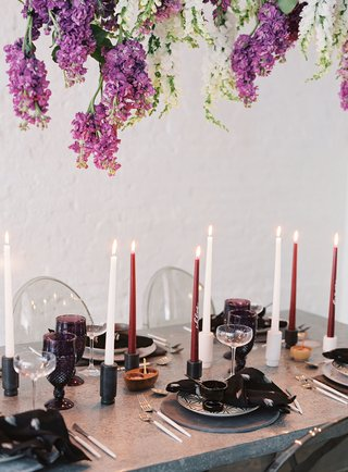 wisteria-flowers-metal-silver-table-tall-taper-candle-purple-colored-glassware-modern-tablescape