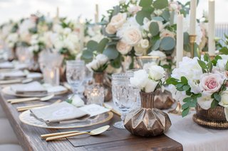 wedding-reception-table-wood-with-dark-metallic-bronze-vase-antique-glassware-white-flowers-gold