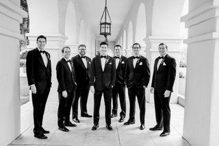 black-and-white-photo-of-groom-posing-with-groomsmen-in-arizona