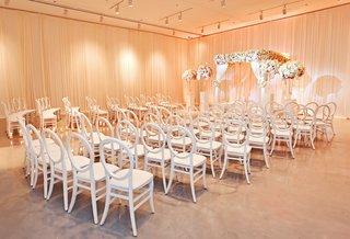 wedding-ceremony-seats-white-cushionless-round-back-cahirs-peach-uplighting