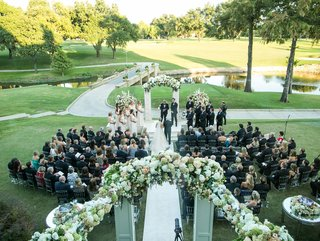bride-and-father-walk-down-aisle-with-guests-at-country-club-golf-course-in-dallas