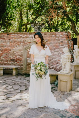 bride-with-long-brunette-hair-red-lipstick-v-neck-sheath-wedding-dress-short-sleeves-natural-bouquet