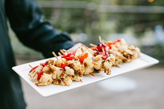 cauliflower-and-roasted-red-bell-pepper-kebabs-at-tapas-bar-tray-passed-appetizer-wedding-ideas