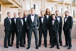 wedding-party-groom-and-groomsmen-in-dark-suits-and-purple-bow-ties-matching-fall-wedding-ideas