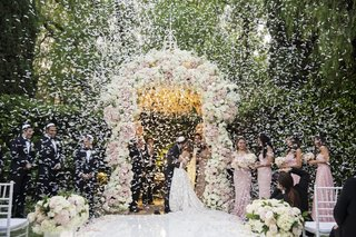 wedding-ceremony-first-kiss-as-husband-and-wife-beverly-hills-hotel-confetti-canon-white-pink-flower