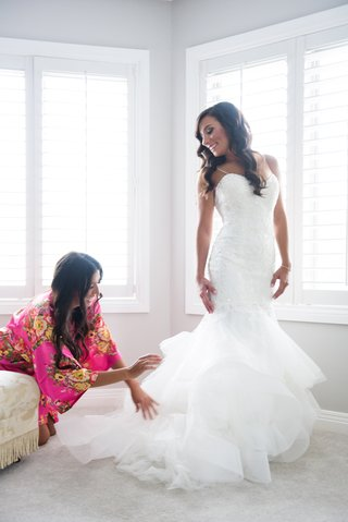 bride-in-monique-lhuillier-mermaid-wedding-dress-maid-of-honor-in-robe-fluffs-bridal-gown