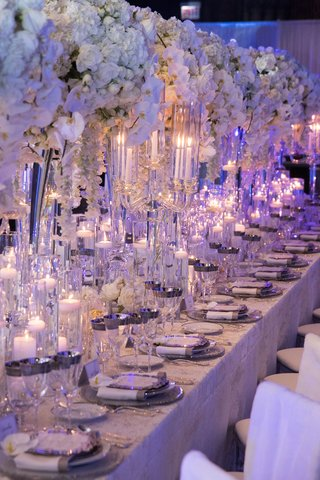 wedding-reception-long-kings-table-white-orchid-rose-flowers-silver-charger-glassware-floating