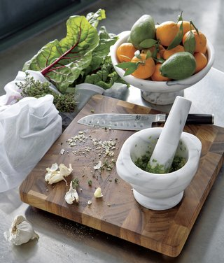 mortar-and-pestle-on-cutting-board-wedding-registry-ideas