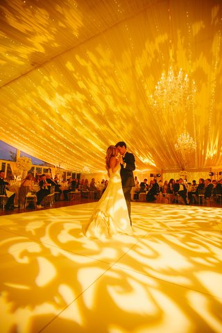 bride-and-groom-dancing-beneath-twinkling-lights