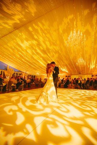 bride-and-groom-dancing-beneath-twinkling-lights