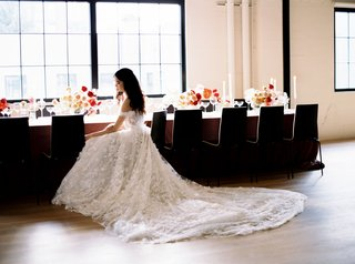 wedding-reception-styled-shoot-bride-in-galia-lahav-wedding-decor-chairs-around-table-velvet-linens