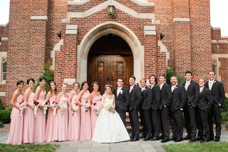 bride-and-groom-in-front-of-church-with-bridesmaids-and-groomsmen