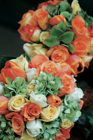 flower-bouquets-of-orange-yellow-and-white-roses-and-green-hydrangea