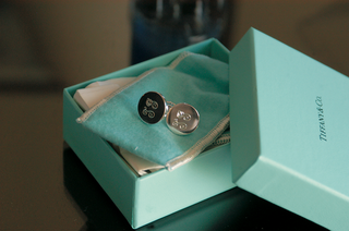 tiffany-and-co-blue-box-open-to-display-silver-and-black-cuff-links