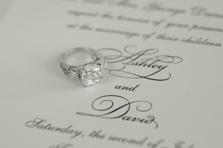 princess-cut-bordered-by-oval-side-stones