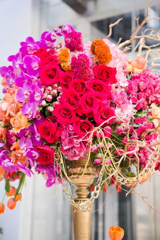 jewel-tone-blooms-tall-centerpiece-roses-orchids-tulips-branches-gold-details-wedding-reception