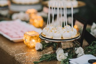 gold-sprinkle-dusted-white-cake-pops-and-pink-macaron-desserts