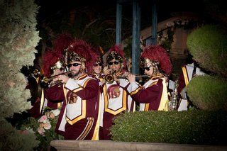 the-university-of-southern-california-trojan-marching-band-performing-at-evening-wedding-ceremony