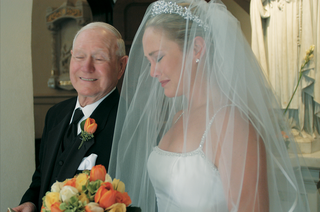 father-of-the-bride-walks-his-daughter-down-the-aisle