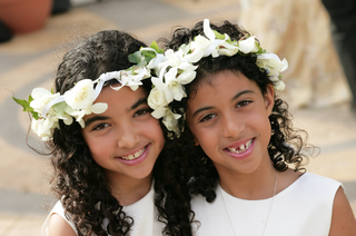 curly-hairstyles-with-crown-of-flowers-on-head