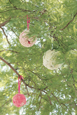 ball-of-flowers-and-ribbon-hanging-from-tree