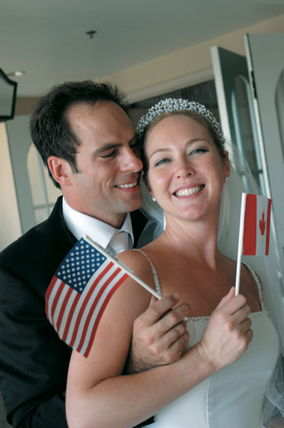 bride-waves-canadian-flag-and-groom-waves-american-flag