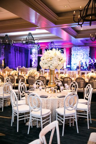 ivory-flowers-on-thick-gold-vase-textured-cream-linens-white-chairs