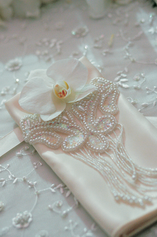 white-table-linens-and-fancy-napkins