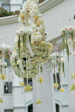 chandelier-covered-in-flowers-and-crystals