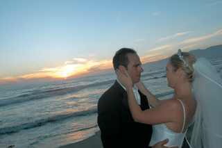 newlyweds-gaze-at-each-other-on-beach