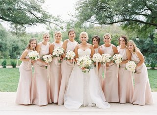 wedding party bridal party bride in strapless wedding dress overskirt bridesmaids in high neck dress