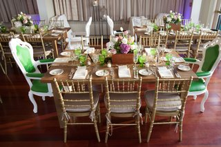 wedding-reception-wood-table-with-green-glassware-high-back-white-and-green-chairs-and-gold-chairs