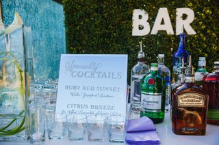 specialty-cocktail-drinks-featured-at-drinking-station-with-bar-marquee-letter-sign