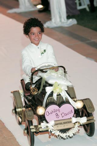 cute-little-boy-driving-car-down-aisle