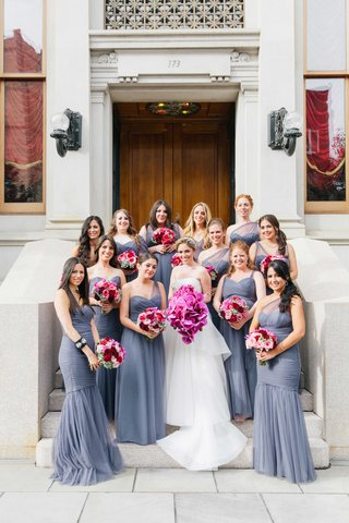 bridesmaids-in-one-shoulder-amsale-mismatch-mermaid-bridesmaid-dresses-with-pink-and-purple-bouquets